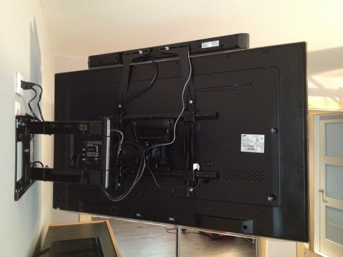 soundbar behind the tv